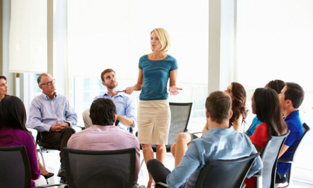 3 important leadership qualities for business owners - woman speaking to group of people
