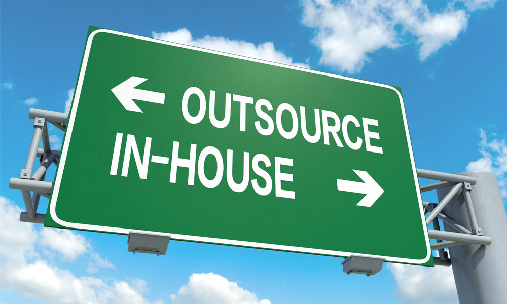 3 reasons change perception of outsourcing - Street sign with outsource one way and in-house the other way.