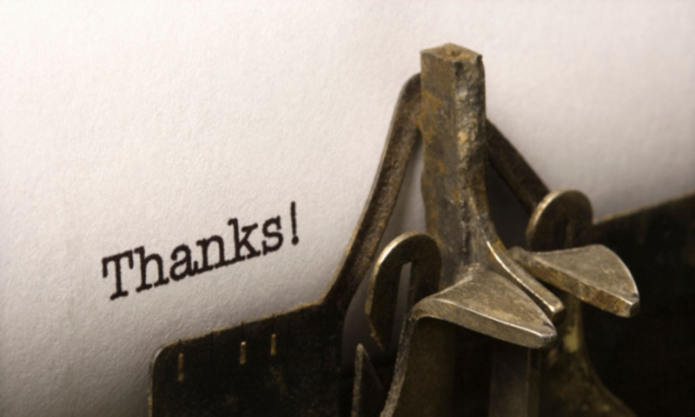 3 simple ways to say thank you to employees - typewriter with thanks on typed on paper