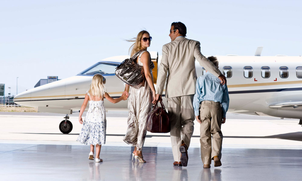 are you considered rich in your city - family of four getting on private jet