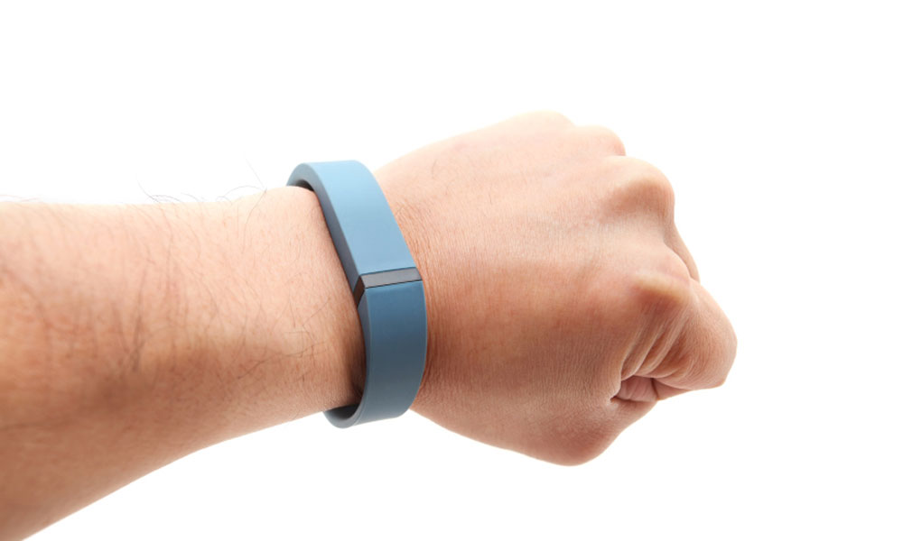 could fitbit be the right fit - arm with a blue fitbit