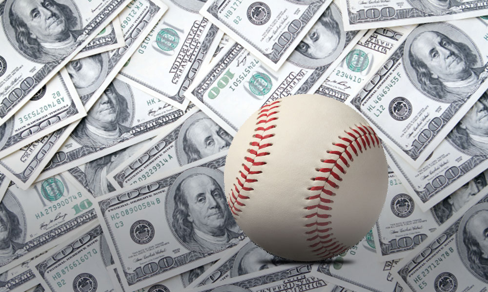 do giants payrolls win word series - baseball on top of a pile of 100 dollar bills