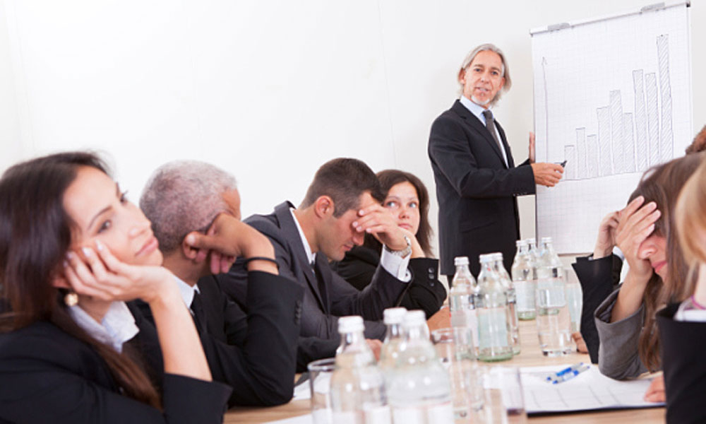do you hate your job - man speaking to a conference room full of people