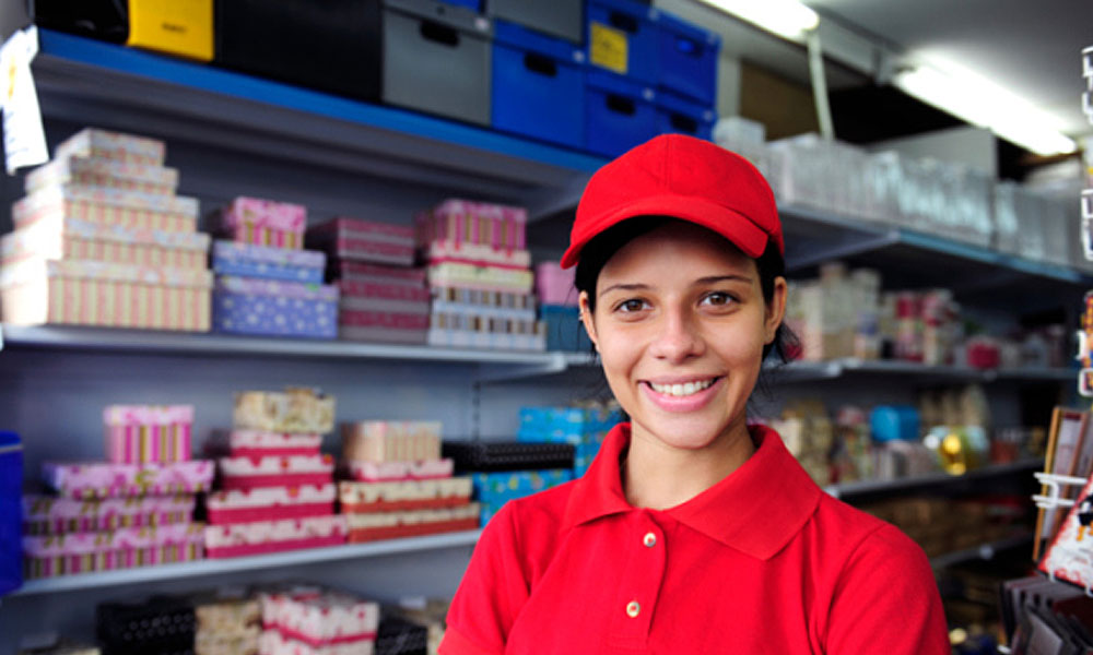 do you have to pay for employee uniforms - woman in a red uniform in store
