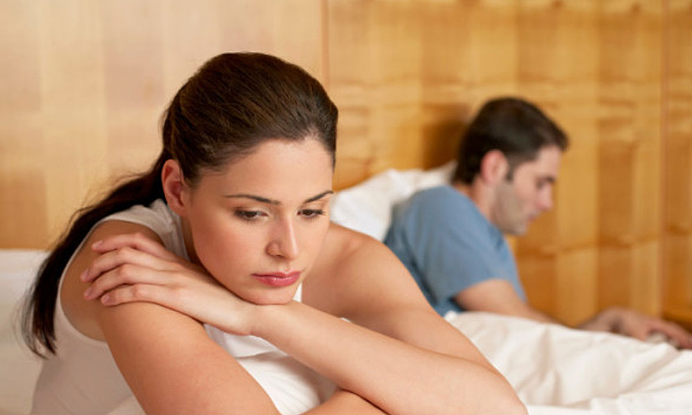 don't get into nanny tax trouble - concerned woman in bed with man