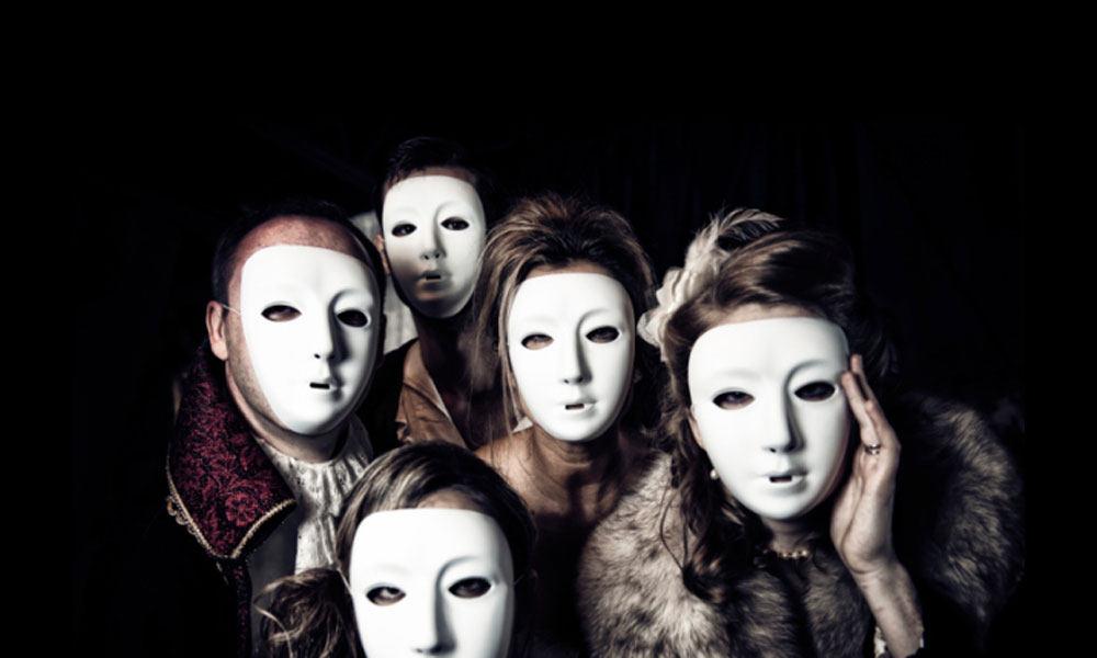 Halloween costumes not to wear - group of people wearing white face masks