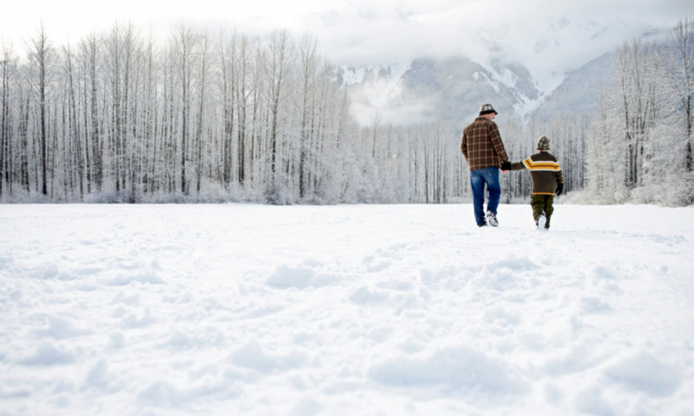 how to take a holiday break owning a small business - father and son walking in the snow