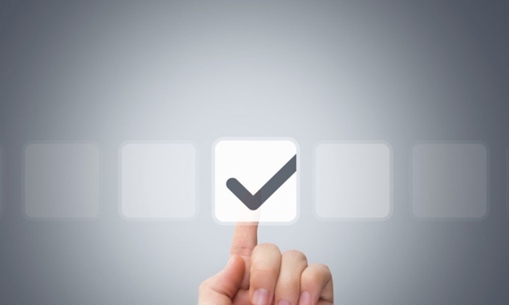 new hire checklist day one details - finger clicking a check mark button