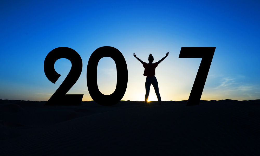 Optimistic ownership are small business owners optimistic 2017 - Sunset with a 2017 sign in the the forefront