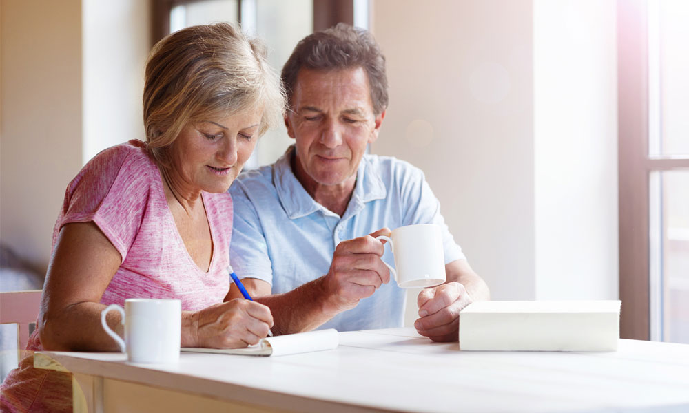 retirement planning replacing valued employee - an older man and woman planning retirement