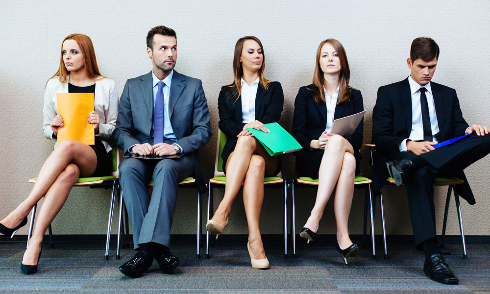 small businesses get aggressive on hiring - three women and two men sitting on chairs waiting for an interview