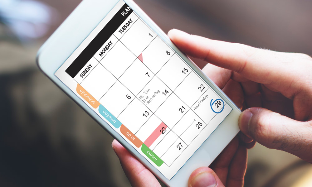 the payroll schedule how to create one - Smartphone screen with a calendar