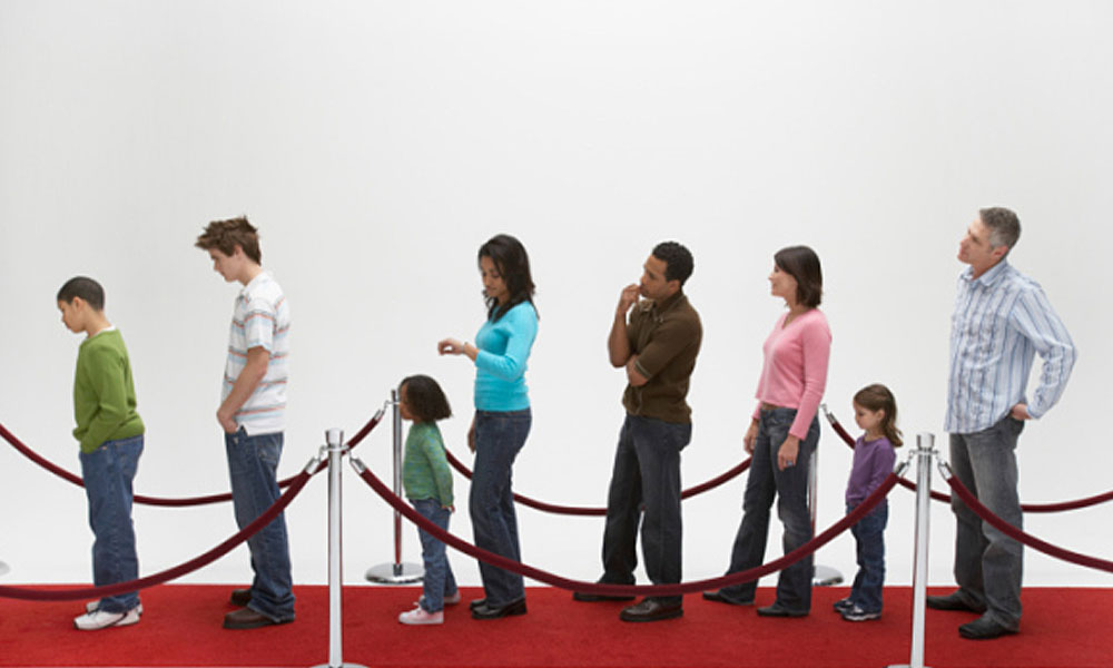 the roi on top grossing movies 2013 - people waiting in line to see a movie