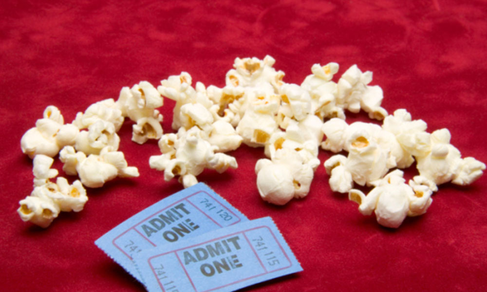 the top 5 movies about business, popcorn with two tickets