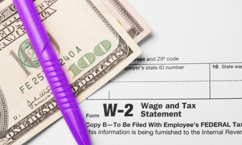 the W2 blueprint - W2 form with $100 bill and a pen