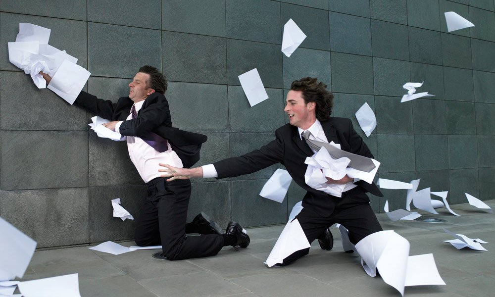 what is customer attrition why does it matter - two men in suits chasing paperwork blowing away