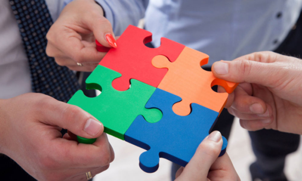 what you should know about s-corps and llcs - hands putting puzzle together