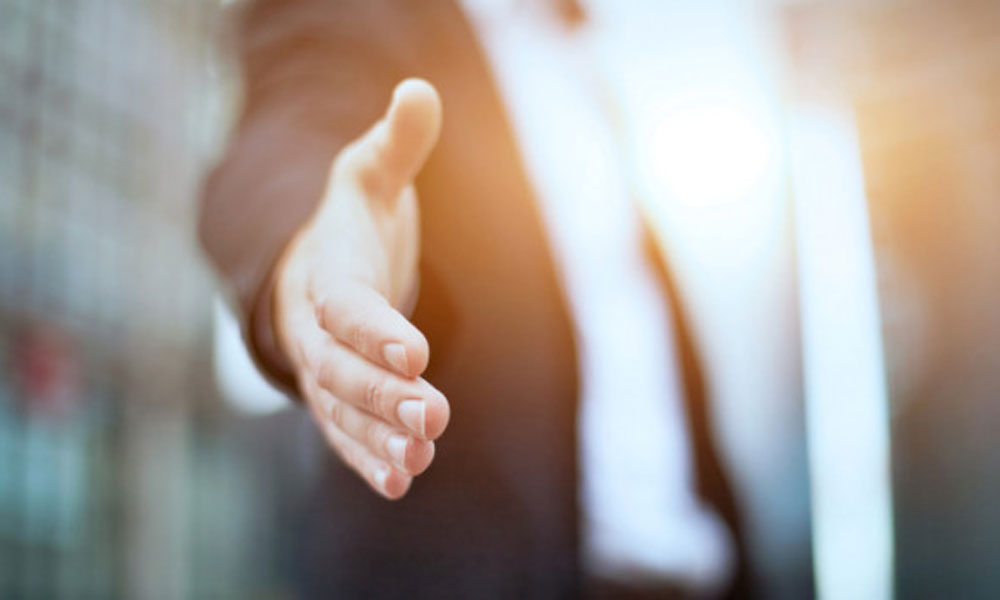 why January is a good time to recruit - man reaching out for a handshake