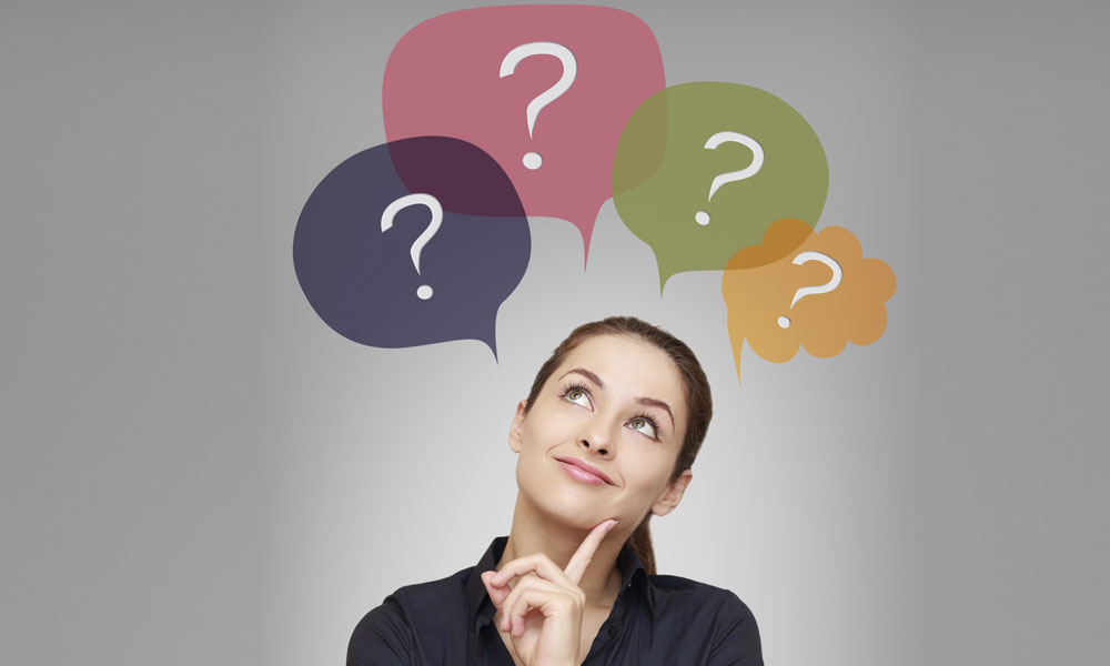 write good proposal request - woman looking up with multiple question marks above her head