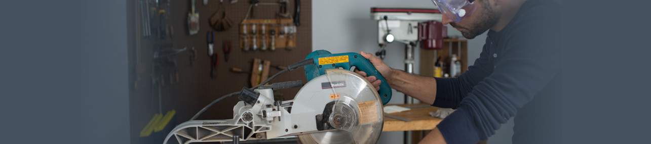 Workers Compensation Header - Man using a skill saw