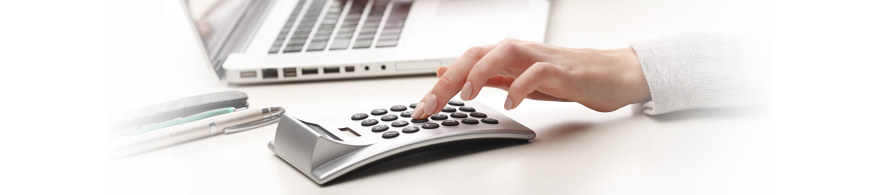 Accountants Page Header - person using calculator on a desk