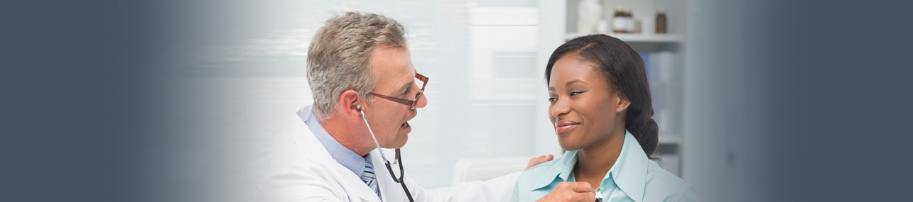 Health Insurance Header - Doctor giving an exam